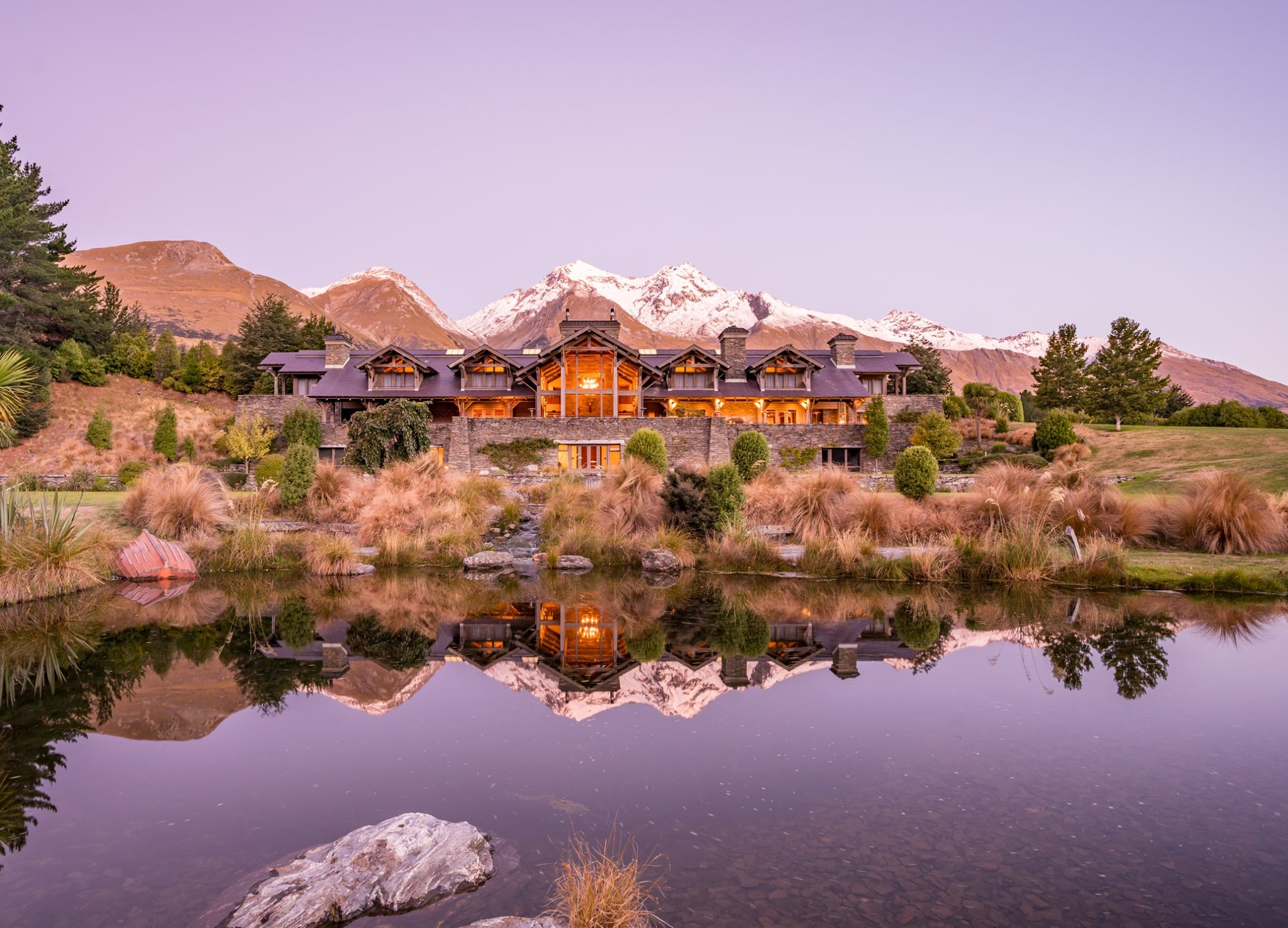 With world-class dining, spectacular scenery, and authentic kiwi hospitality, traveling through New Zealand via its acclaimed luxury lodges is the best way to capture the essence of this remarkable land.