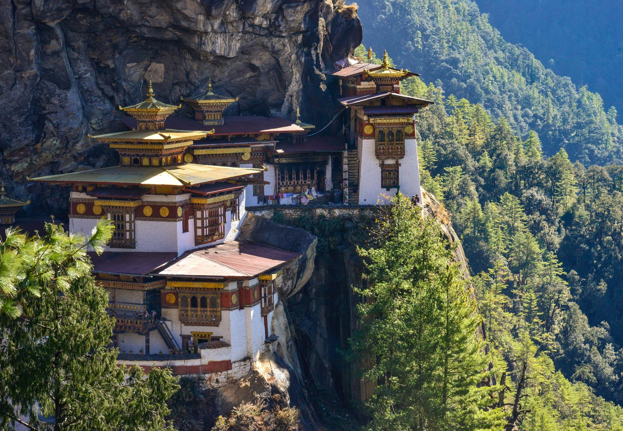 Nestled between two gigantic neighbors, the tiny kingdom of Bhutan is a majestic, serene, and breathtakingly beautiful hideaway high in the Himalayas.