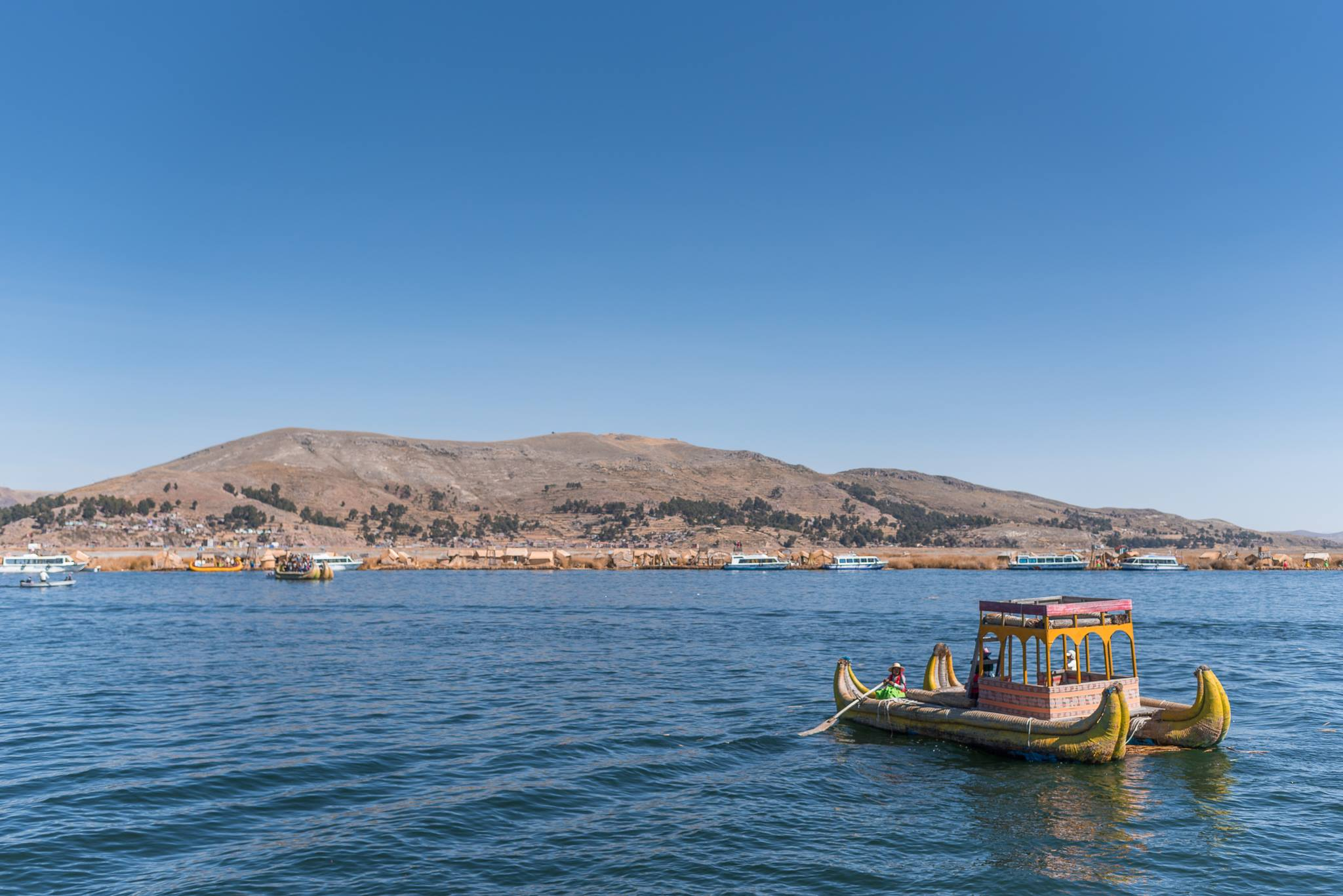 Peru's ephemeral floating islands, golden-hued and gracefully delicate, appear like a mirage in Lake Titicaca. But their origins, paradoxically, reflect the strength and tenacity of the native peoples who created them.